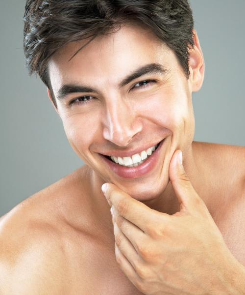 a man smiling after dermal fillers